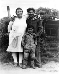 Big Mike Hodikoff, Chief of Native Aleut Tribe On Attu, Wife and Son, 1934. U. S. Navy Photo. [George & Nadine Smith]