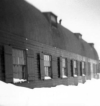 Attu's South Barracks, 1946. Rene Thibault's bunk was under the middle window on the second floor.  [Rene Thibault]