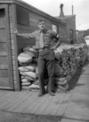 "J. Rene ""Frenchy"" Thibault standing by the door of the Guard Shack, Attu, 1946.  [Rene Thibault]"